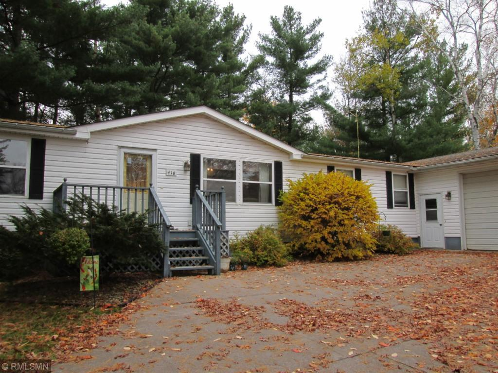 """Rare opportunity...Private wooded setting on Arlington Blvd in Amery.  This spacious 4 bed, 3 bath home sits on almost 3/4 acres,  2 lots, features attached double garage and large heated shop, and large lower level family room.  Enjoy the """"Up North"""" feel in the wooded backyard, family campfire ring and room to roam.  Back lot has driveway access.  North Twin and Pike Lake are close by."""