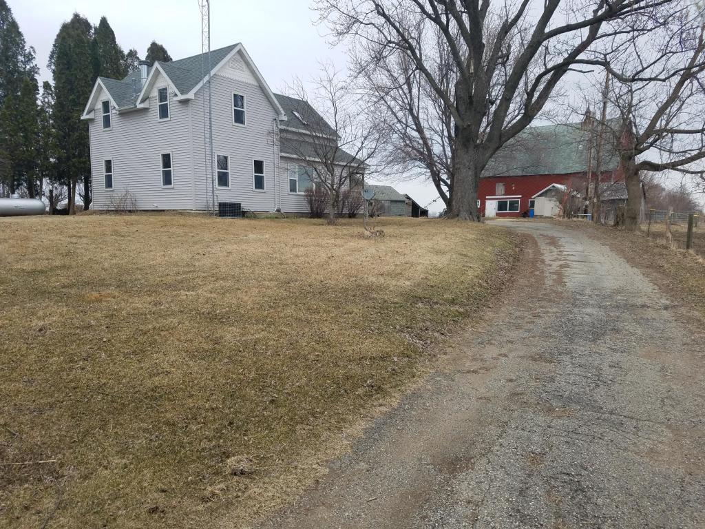 39 acre Hobby Farm located in the township of Sharon. Numerous outbuildings and a large L shaped detached garage that measures 28x40 and 24x24. The 1.5 story house has been remodeled and shows well. Family room features a natural fireplace, large living room, and an updated kitchen. Upper bedroom suite with a balcony/deck.