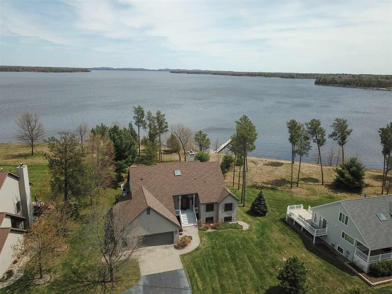 Castle Rock Lake. Enjoy Beautiful Views from the Shores of Sugar Sand Beaches of O'Dells Bay, Private Waterfront Community. 4 bed 3 bath home offers tons of rm for entertaining w/huge family room with wood stove to take the chill out on those cold nights. Stone fireplace to the vaulted ceiling in the great room, granite counters in the just updated kitchen & octagon tray ceiling in dining area makes this great room so cozy. Spa like new Mst bath, Mst bed rm w/patio doors to the deck & sunken Hot Tub.  Large garage w/extra storage for boats too. Beautiful lake views from the loft.  Sunrise views are stunning!