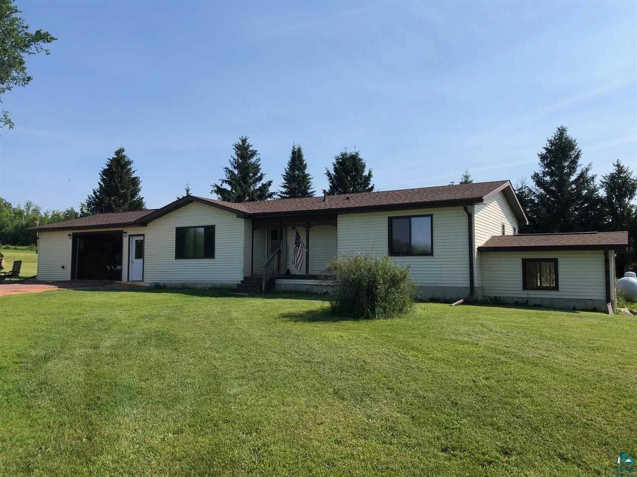 Ranch style home on 40 acres in a beautiful location. This home features a new attached garage with in-floor heat.  Spacious living room connected to the dining area and kitchen.  Full basement with a walkout for more living space.  Basement has potential for finishing and using for more rooms,   Large pole building and fences for animals. Very private location and located on a dead end rd. Partially finished basement has great potential for extra living space and a 3rd bedroom. With field and outbuildings, this property could make an ideal hobby farm! Great hunting, as well.  Possibilities are endless!