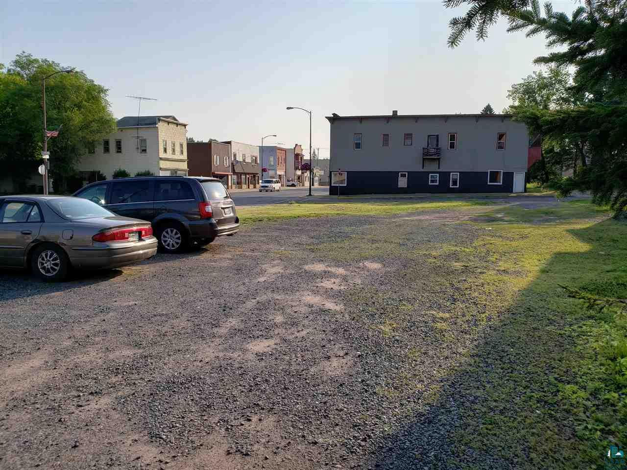 Located on the corner of Main Street & Willis Avenue in Ashland's City Center, this vacant lot offers a large commercial corner. Just blocks away from Lake Superior with views of the Chequamegon Bay, you also have instant exposure to the traffic and foot traffic on Main Street.  Great place for a Food Truck, Coffee Shop or to use as additional parking for your current business. This property is Zoned City Center.