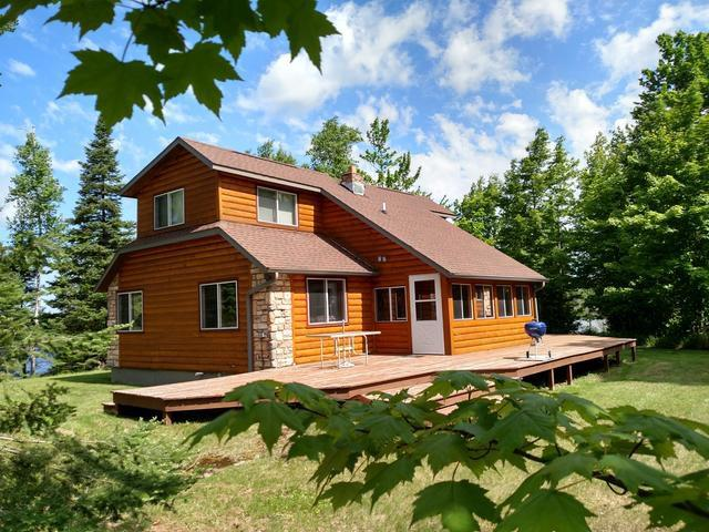 Are you looking for something very private and remote away from that busy lifestyle? Then this place is for you! This beautiful Log Sided Home is on a very secluded 146 acres of its own private 27 acre lake which has a depth of 20 +/- feet and an abundance supply of Panfish, Largmouth Bass and Northern Pike present. The 2 Bed and 2 Bath home has been nicely updated and features a wood-burning fireplace, large deck, and a large 40x60 pole-shed for all those recreational toys. This private setting has trails throughout the property and also borders thousands of acres of USA land. The property is also very close to the Pike Lake Chain and many other area lakes. If you are looking to Hunt, Fish, snowmobile, use your ATV or just enjoy the peace and quiet then Schedule a Showing Today for this rare opportunity!