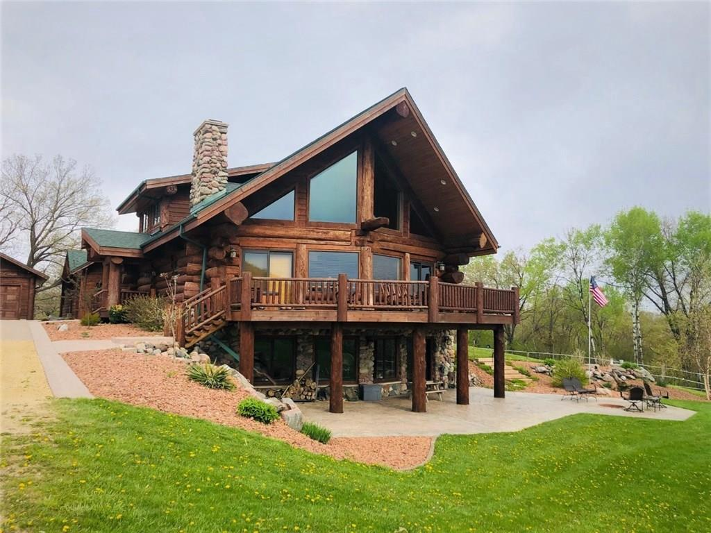 Stunning! This home is a one of a kind Pioneer Log Home.  Built like no other log home, the quality and size of the logs is breathtaking.  Nothing spared in the quality of the interior finishings.  Copper sinks, hickory cabinets, tile walk in showers, two beautiful stone fireplaces, antler chandelier, hot tub in master bath.  The list goes on... All this in a secluded setting with the best of views.  Plus a 100x42 pole barn, shed with sliding barn doors and overhead doors with openers.