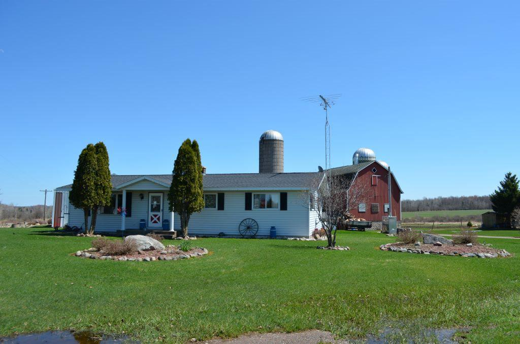 3 Generation Farm. 3 bdrm, 1.5 bath, open concept with main floor laundry. Fuel forced air with Hardy outdoor wood burning furnace helps for low cost heating. (2) 1000 gal holding tanks. Several Buildings include: Dairy bar is 36 x 124, Milk House: 14 x 16 with additional storage. 3 Silos, Open sided heifer shed 32 x 24. Machine Sheds: 36 x 70 metal shed with 12 ft side walls, 45 x 90 metal shed with 14 ft side walls. More information is available upon request.