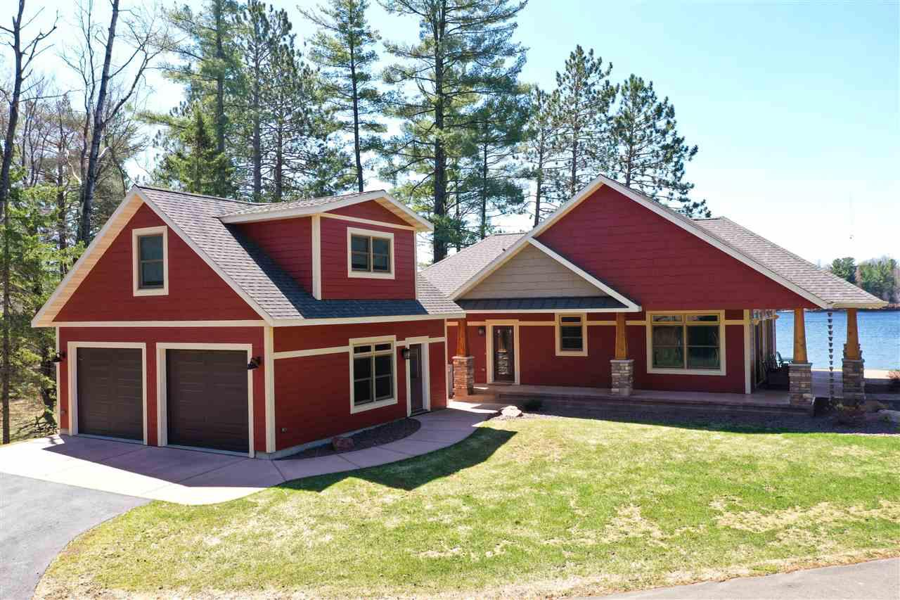Exceptional 2+ bedroom, 2 bath lakefront home on beautiful Lake Esadore. +/-.55 acre lot at the end of a blacktop road with +/-366 feet of water frontage. Built in 2014 this home features an open concept design, master bedroom with trayed ceiling, master bath and main floor laundry. Custom kitchen with Great Northern Kitchen Cabinetry and a Cambria topped island with breakfast bar. Living room with a wood burning fireplace. Lakefront views can be seen throughout. Desirable location with southern exposure looking over the lake. Detached 2 car garage with finished loft/bonus room above. The stove, refrigerator, dishwasher, microwave, window treatments are dock are included in the sale price.