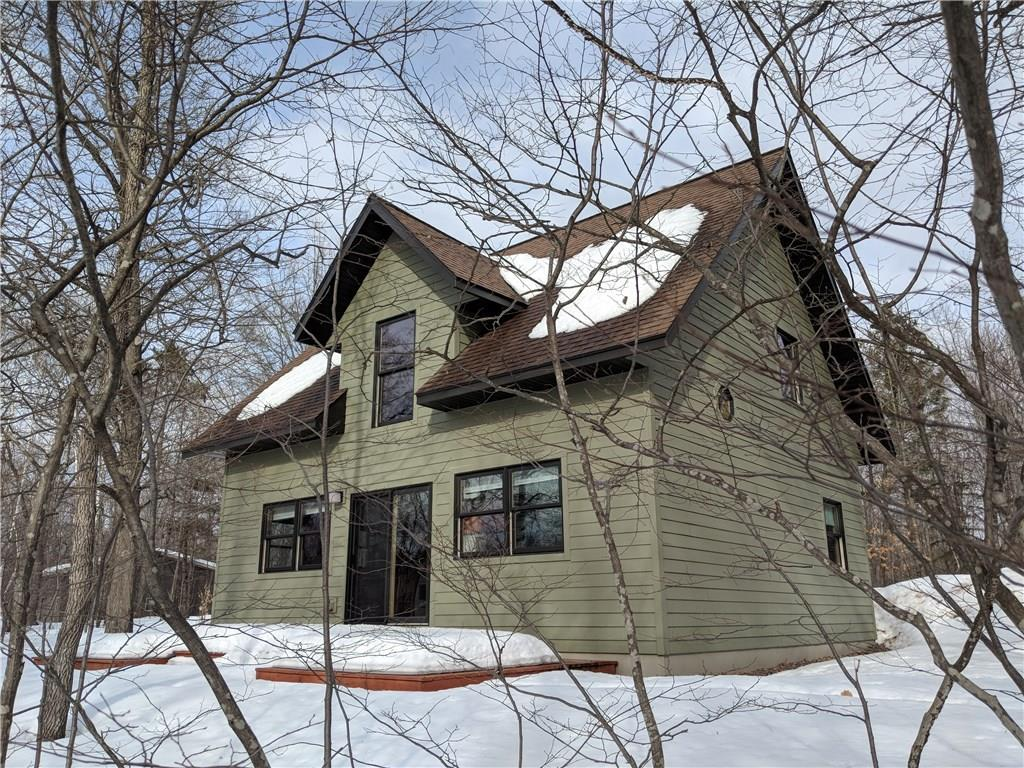 WHAT A GEM! Are you looking for a fantastic get-away or a year round home. This home is a great spot to kick your shoes off and sit on your deck to watch the Flambeau River flow by. Plenty of room with a 10 X 30 loft for your company.  Nicely wooded area. Check this out! It won't last long.