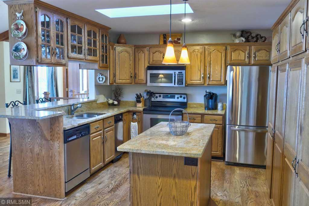 Submerse yourself in the Lake Life at this spacious Lake Wapogasset property. This home boasts a wonderful sunroom, 2 main floor suites and panoramic views. A second kitchen in the basement makes this the perfect set-up for two families. The main floor has four bedrooms, three bathrooms, a wood burning fireplace and vaulted ceilings. Large windows and skylights fill the rooms with a lot of natural light. Granite countertops, an island with a built-in wine cooler, SS appliances and a generous amount of storage make the kitchen perfect for entertaining. The larger mst suite and one of two staircases to the basement encompasses one end of the home. There's even access from the mst closet into the laundry room. In the basement, you'll find an amazing game room w/ it's own half bath, a gas burning fireplace in the family room and an inviting screened porch. Come take a look at this beautiful property and it's stunning views of Wapogasset. Lake Life at it's finest! No showings until 5/15/20.