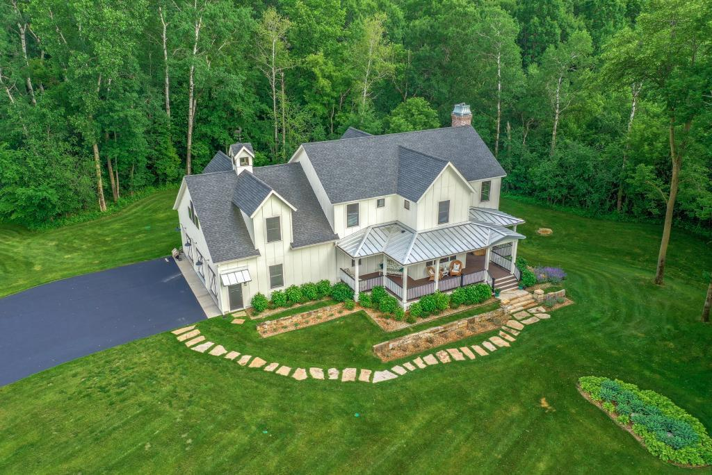 Stunning custom built Hartman home. You will absolutely love this modern day farmhouse with all the old world charm and character but with all the modern day amenities. 5500+ sq ft 5 bedroom 5 bath. Huge inviting front porch. No detail was missed in this home. Luxury kitchen and finishes throughout. 3 fireplaces, amazing lower level with rustic barnwood bar details. Perfectly placed on a 4.2 acre wooded lot. Beautifully manicured yard and landscape. This home is located near Troy Burne Golf Course and only minutes from Hudson and I-94 accessed. This home is truly a must see!