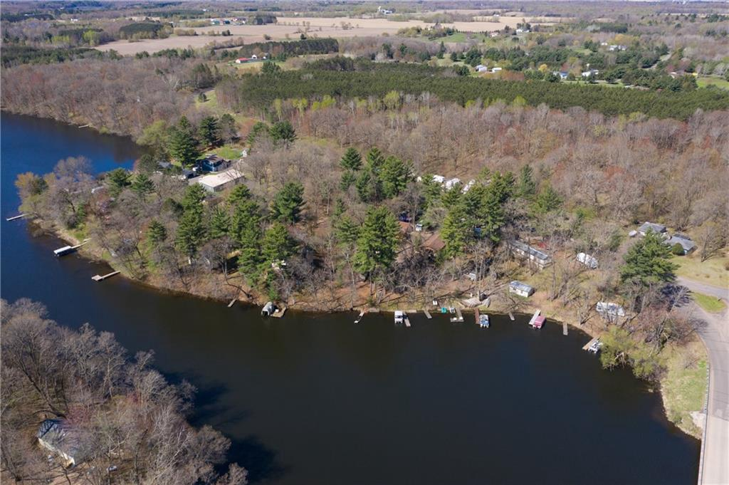 Have you ever dreamed of owning your very own resort? Well here is your chance! The Ginger Rogers Resort and Campground is for sale! It sits on 7+ acres and has a 2 bed 1 bath main house, 6 rental cabins, 11 trailer spots, a rental trailer, 2 pontoons, 8 boats
