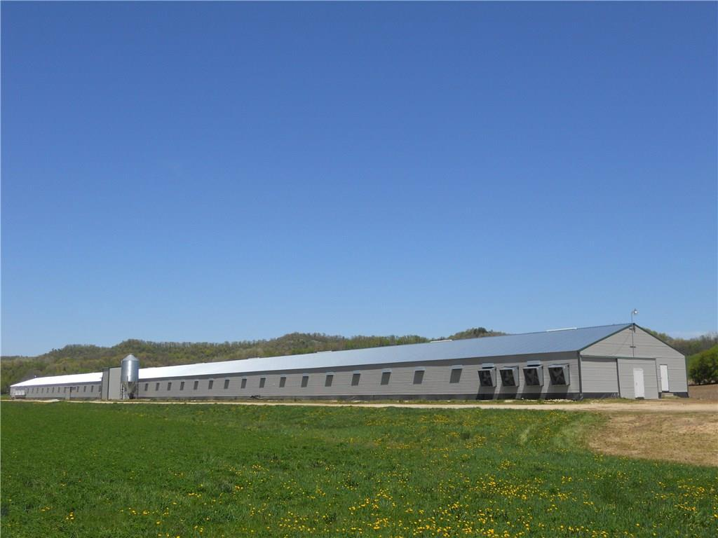 """Chicken breeder barn just outside Arcadia, built in 2007, has been very well kept with regular maintenance/updates performed to make this a turn-key operation. Features include newer feed system, newer grain bins w/ electronic scales, newer steel roof and vents in 2017, newer nests, all stainless steel cables, hot water, & bathroom. Whether you're looking for a new career to """"be your own boss"""" or are looking for an investment, this property is a great opportunity! Call now or you'll miss out!!!!"""