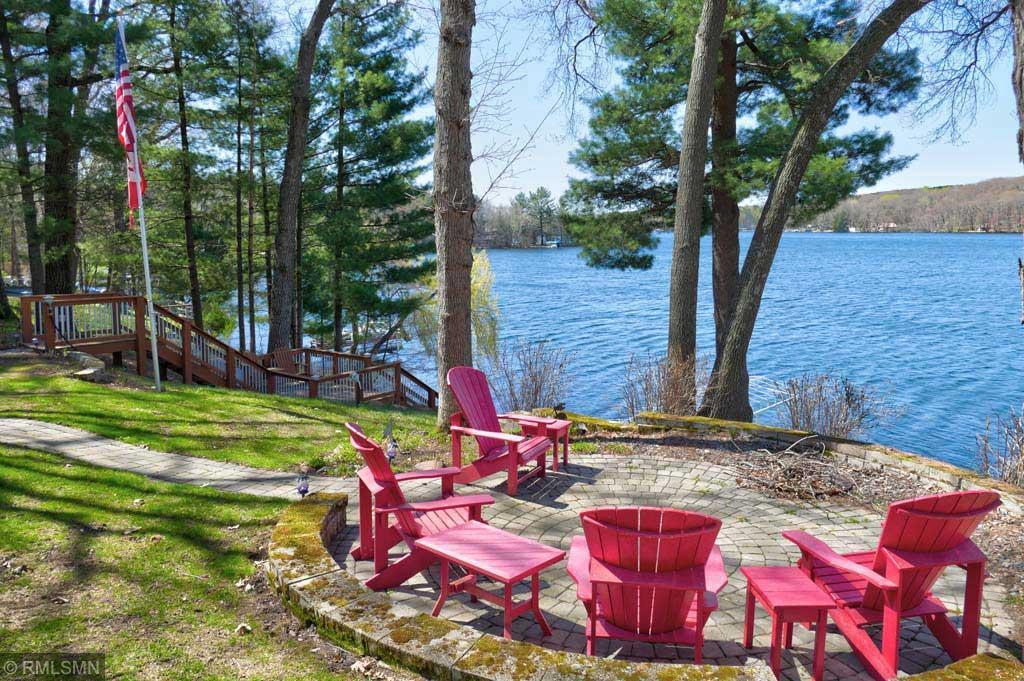 Beautiful property on exclusive, tree-lined Longwood Rd w/ 109' of Lake Wapogasset frontage. The 20 property owners on Longwood Rd share 41 wooded acres to walk, run or ATV through. Your new lake home features a private, 550' long asphalt driveway, an attached and detached garage (both insulated/heated) for all the toys, two outdoor firepits and once you're at the lake, over 1,400 acres of fun between Wapogasset & Bear Trap Lake. Boat to the lakeside marina or bar/restaurant to enhance the Lake Life living. The home features recent improvements such as a four-season porch, windows, roof, kit cabinets & countertops, carpet & tile, wood fireplaces, water purification system and generator. The open kitchen/living/dining with adjacent wetbar and deck is perfect for entertaining. Relax in the four-season porch w/ panoramic lake views and a wood-burning stove. The lower level bar & family room w/ wood-burning fireplace are ideal for escaping from the little ones. This is the Lake Life!