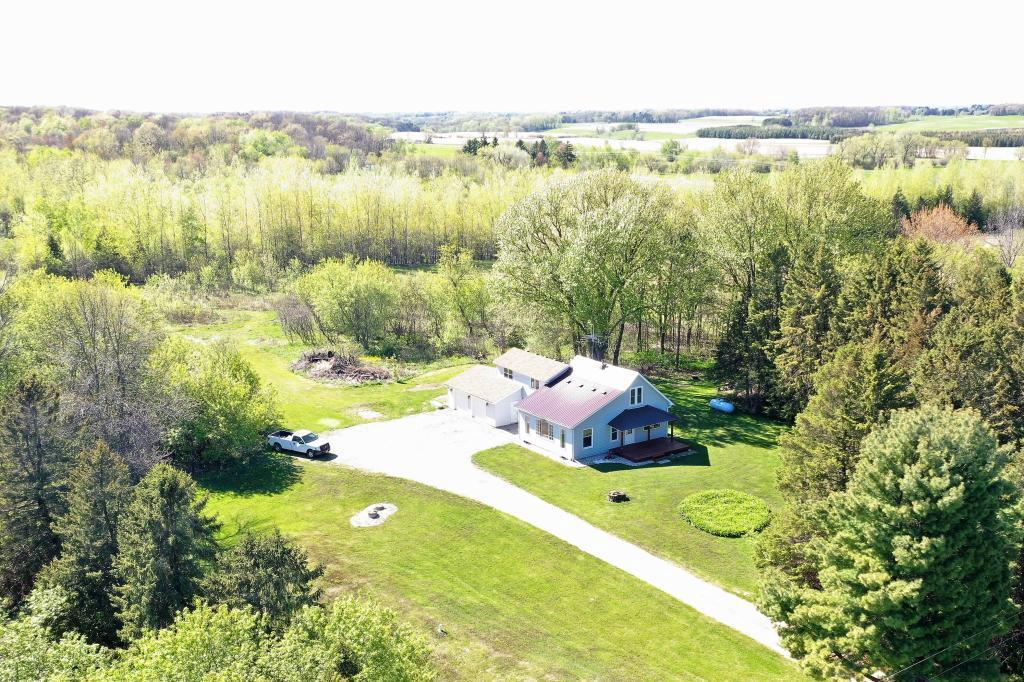 A rare find, just outside of River Falls! Come visit this updated farmhouse on just shy of 5 acres, and only a 12 minute drive to downtown River Falls. This home features 2 extra large bedrooms, 2 updated baths, fresh paint and new flooring throughout, appliances in 2016, new AC and furnace in 2016, brandnew deck off master bedroom in 2020, room to expand with an unfinished basement, and charming front porch!