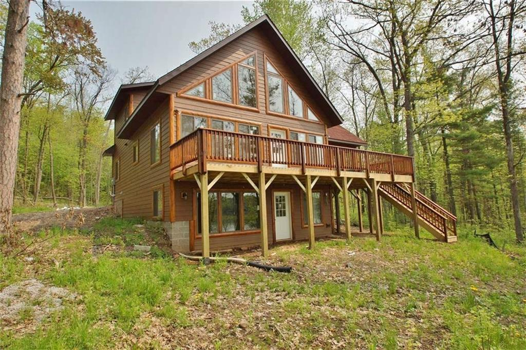 Big Sissabagama--Enjoy lake life at a brand new chalet on this 800 acre lake located near the town of Stone Lake.  Currently under construction, the 3 Bedroom/2 Bath cabin is designed with an open concept LR/kitchen/dining area, with 2 BRs/1 bath on main floor, master suite in the loft, and an unfinished basement. You'll love the low maintenance siding, views from the cabin, real stone fireplace, screen porch and deck overlooking the lake. The 0.71 acre lot has 111 feet of shoreline with northern exposure.  Big Sissabagama is known for its fishing, Blueberry Point sand bar, intriguing islands, boating, kayaking, skiing, wildlife and Friday fish frys! Easy access to Stone Lake, Hayward and Spooner. Lake restrictions before 10am and after 6pm.  Conners Lane is a township maintained road.  Some photos are facsimile; others show work in progress.