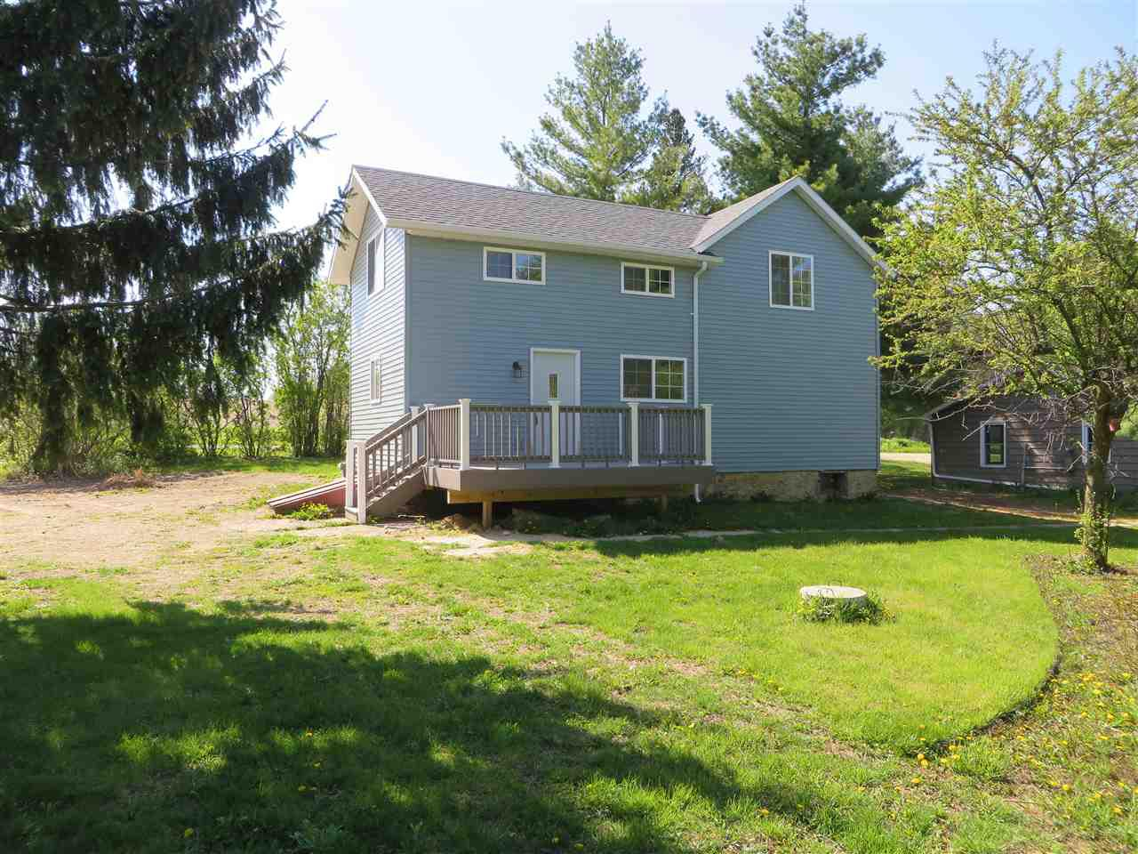 Come live in the country at the edge of Hanover! This completely renovated farm house was taken down to the studs. In the last year and a half it has a new roof, siding, windows, doors, plumbing, electrical, insulation, dry wall, cabinets, fixtures, furnace, A/C and appliances. Ready to move right in! Includes almost 8 acres with a  trail for horses or to walk. Three nice bedrooms with good sized closets and a bathroom on both floors. Laundry is on the main and kitchen has a large 5x6 pantry closet. Spacious 35x60 Wick building with 2 garage bays and extra storage space. Also a separate end with heated and insulated workshop and a covered 12' attached patio.  Adjacent to snowmobile trails.
