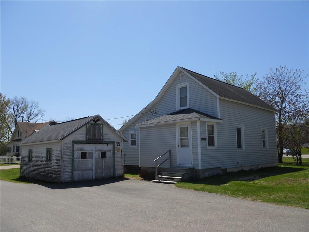 Actual Price to be determined at auction on Mon. June 29@ 5:00pm SHARP!  This 2 bedroom, 1 bath 1.5 story home features a 24x26 detached garage, vinyl siding, many replacement windows, and 100 amp electric service on a large lot!