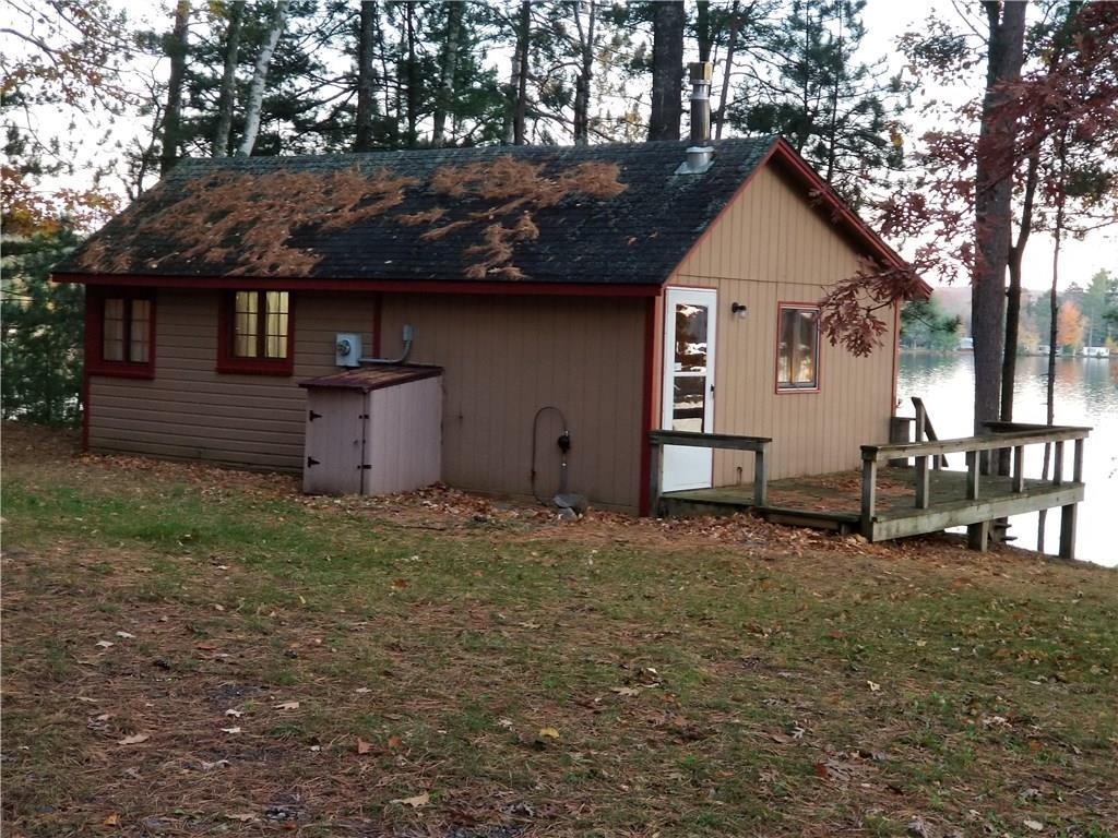 Small cabin on large wooded lot on crystal clear Blueberry Lk with sandy swimming area and impressive views. Drilled well 2016, gas fireplace living room 2016,  appliances 2016. Potential to add on or up to make this your private getaway! Detached garage for boat storage or a place to put toys. Good fishing off the dock for bass, walleye, panfish, and pike. Great location next to the Chippewa Flowage and only 20 miles from Hayward. Snowmobile trail crosses the lake. Most furnishing included.