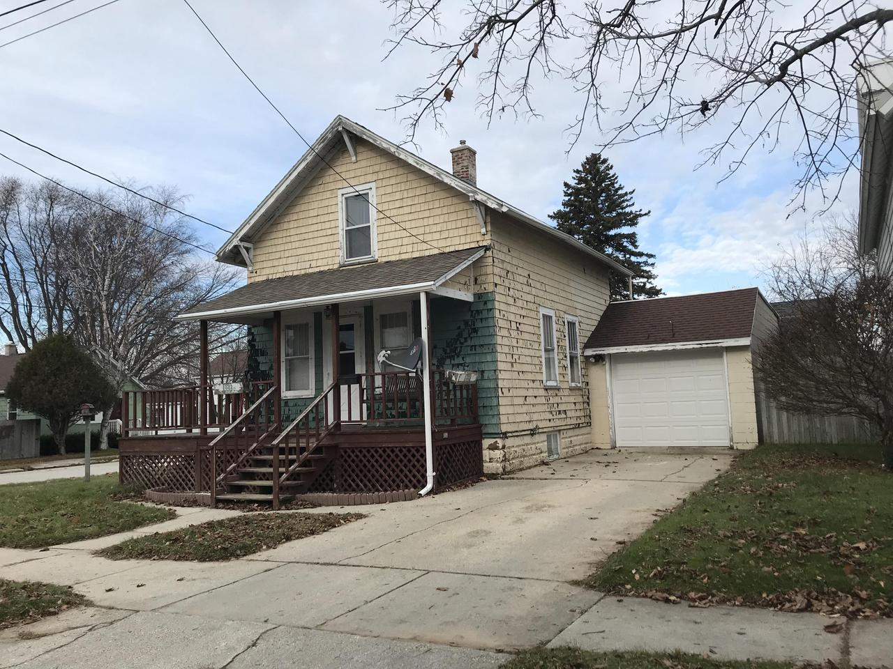 3 BR fixer upper across the street from East Twin River on Two Rivers' East Side. 2 BR upper and one on main level. Large Kitchen with many cabinets and counter top. Central air and GFA put in by seller. Close to shopping, restaurants and bike trail and park.  Being sold ''as is''.