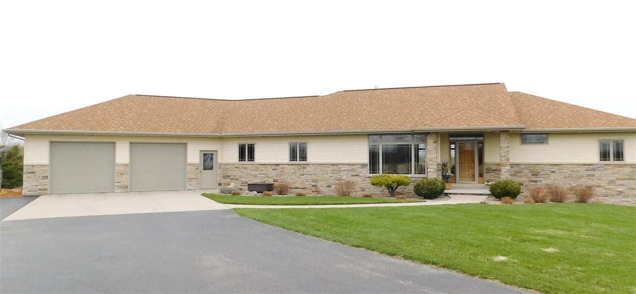 ?Great for Horses? Beautiful, custom built, 1 owner, 3-bedrooms, 2-bath walk-out stone ranch home located on beautiful 11 acre parcel w/Suamico River through rear of land, plus large pond w/perch & croppies. 3-stall heated attach garage plus 2 additional buildings. 30 by 40 ft pole building w/water, electric, dirt flr, & outdoor electric fence. 2nd out building approx 32 x 24 ft w/cement flr, sky windows, dog kennel, & lean-to. Approx 2 fenced acres. Foyer entry, great rm w/brick gas log fireplace, open concept kitchen/dinette, large 1st flr master suite, 2 large beds, 1st flr laundry.