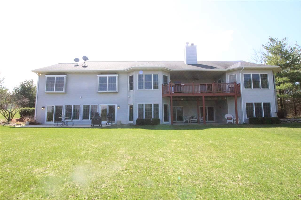 Scenic 5.8 Acres private with Beautiful views! Expect to be impressed with this spacious 13 year old home with 3 car attached garage. Open concept split BR design 4 BR on main floor plus an office, formal dining, attractive Fireplace, dinette, walk in pantry, breakfast bar, plenty of cabinets, an island & French doors lead to a nice size deck which overlooks countryside. Walk out lower level with full size windows, media room, entertainment area with a fireplace, 2 bedrooms, full bath, exercise & craft rooms with walkout to patio & backyard. Perfect for entertaining or mother in law suite. 35x50 Cleary building.  Horses could be allowed with change of zoning to DH