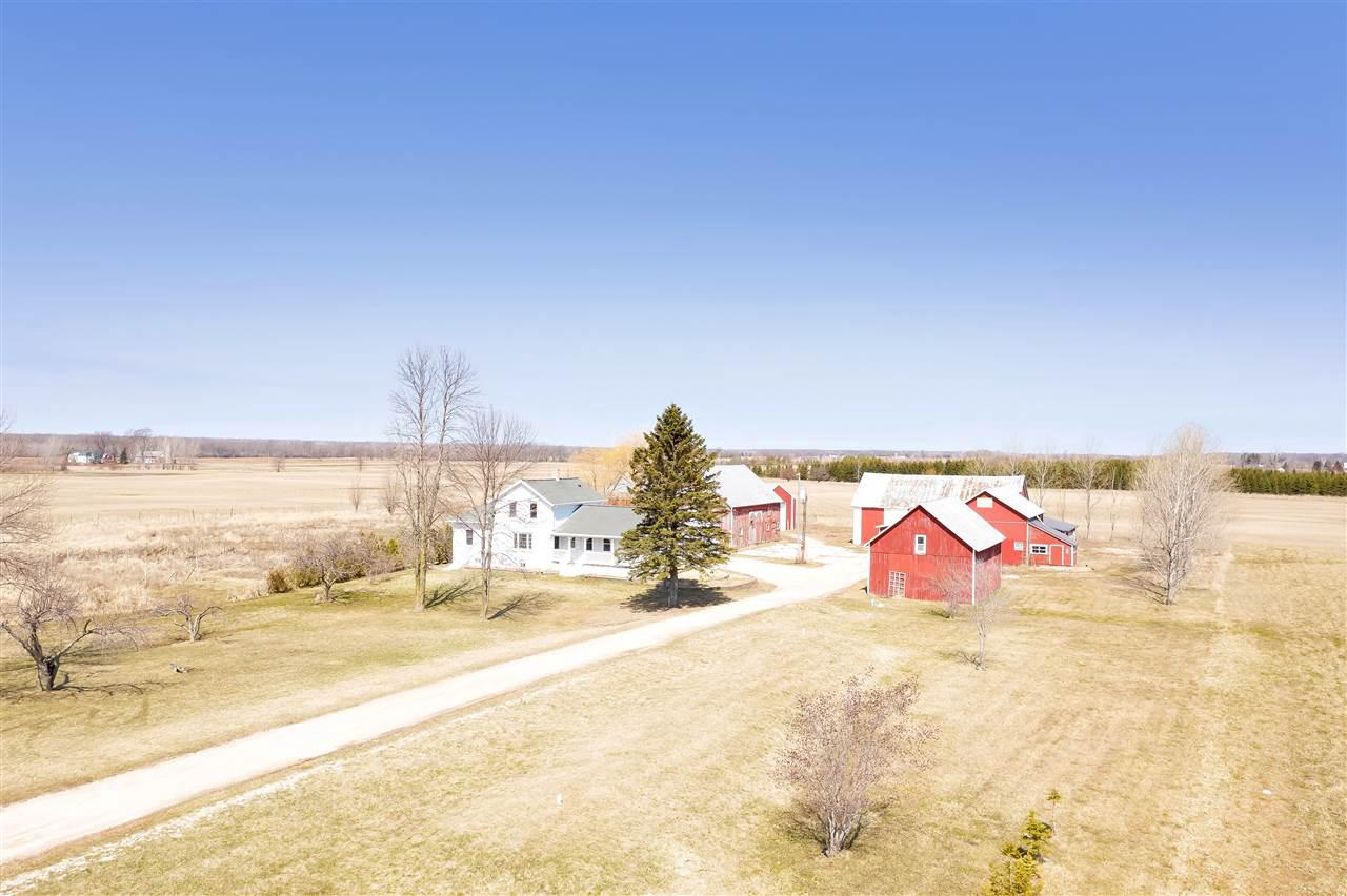 Beautifully updated home set on 5 acres. Kick off your boots in the large mudd room leading to open concept kitchen/living room and 2 large bedrooms. Upper level w/ 1 large bed and full bath w/ tile shower. Main floor laundry. Updates include cabinets, flooring, electrical, plumbing, bathrooms, appliances, mechanicals and more. Mound and well inspection on file. Five outbuildings featuring a 40' x 80' heated & insulated shop with concrete floor. Two barns ready for hobby farming or use as storage. Three stall detached garage with patio perfect for grilling or entertaining!