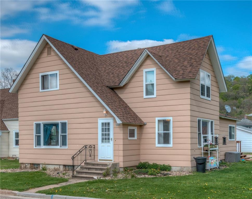 Great home and great lot-very well cared 4 bedroom, 2 bath home on 2 1/2 lots. 3 bedrooms and 1 bath on upper level. Main floor dining, living room, kitchen and bedroom. Deck. Two 1-1/2 car detached garages. Lots of green space for garden or play. Set up your showing today.