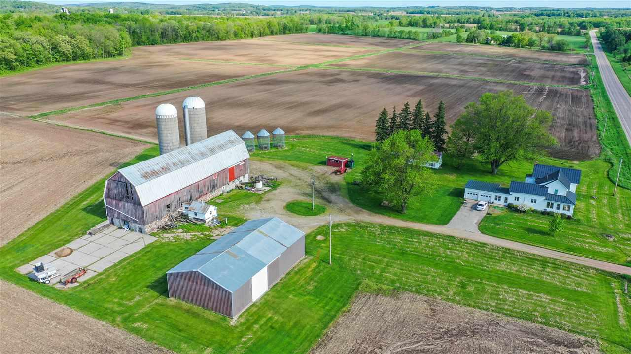 Farm with acreage. Many updates have been done to the farmhouse. Functional Barn and Pole Shed with a Chicken Coop/Garden Shed. Tillable land and recreational land. Currently planted with soy bean and corn. External Boiler wood heat option and LP gas furnace for heat. New Roof, newer mound septic (11yrs), home has wrap around porch, large mud room as you walk in to home. Could be converted to a duplex.  Soil maps available. Great opprotunity to get in to grain farming or have a hobby farm. Well maintained and ready to move in to.