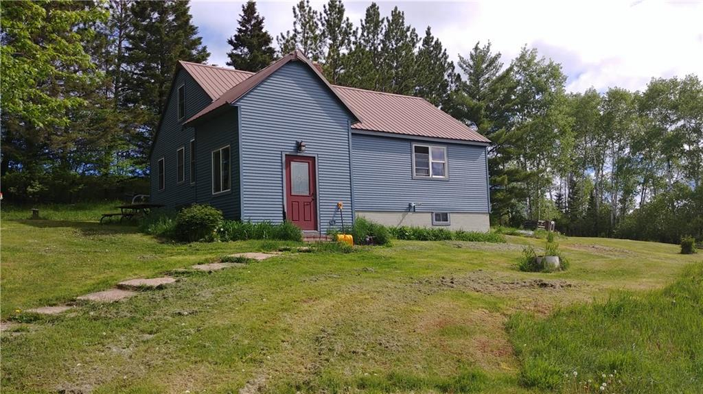 Welcome to 40 acres of peace and tranquility!  Great property to start that hobby farm you always wanted. Comfortable 3 bd/1 ba with many recent updates including insulation, well, septic, siding, roof, heating system and more!  Approximately 8 acres open and 30 acres woods.  Fantastic hunting, fishing and recreation with the Iron River flowing through the property.  Call for your personal tour today! Available with more acres in MLS 1539931.