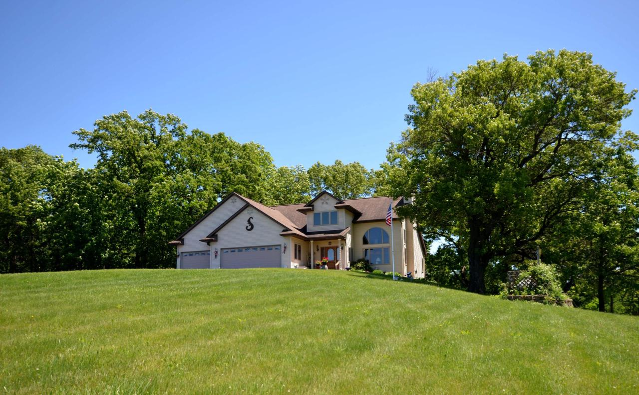 A beautiful, well thought-out home on 15.46 +/- acres of land within a mile of Viroqua is a rarity. Having one on the market is an opportunity for a buyer that doesn't come along very often. 9', 15', & 18' ceilings. Hardwood floors. Many windows & natural light. Beautiful master bathroom w/ walk in glass block shower.   Geothermal heating & cooling w/ dual fuel backup electric ceramic heater & propane generator. heated garage,  50' x 30' pole shed w/ 100 amp service & welding plug. 7-acres of tillable land are currently rented. Could be used for pasturing horses or other animals. Some of the lawn could be converted to farmland or trees. Close to shopping, schools, medical services, golf. Back deck overlooking fern & Hosta garden in a wooded setting attracting wildlife & providing privacy.