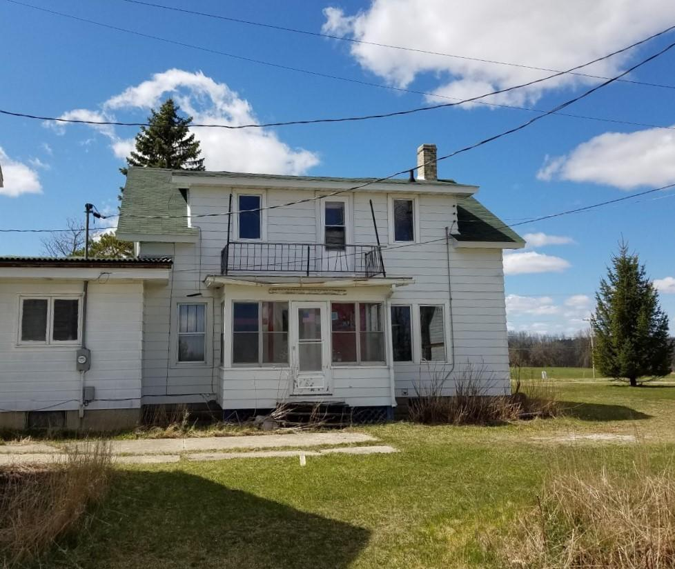 Rural Hobby Farm with 2 Acres Residential and 2.3 acres Agricultural.  Home was originally built around 1900 with add-ons done during the 60's and 70's. Property need lots of TLC.  3 bedrooms, 2 full baths & 2 Half baths,  1 Kitchen is Fully Remodeled.  Detached Garage is 40' x 50' Plus Additional Outbuildings.Agricultural acreage is currently leased.  Property is being Sold As-Is. Any Personal Property Remaining at Time of Closing is Included.