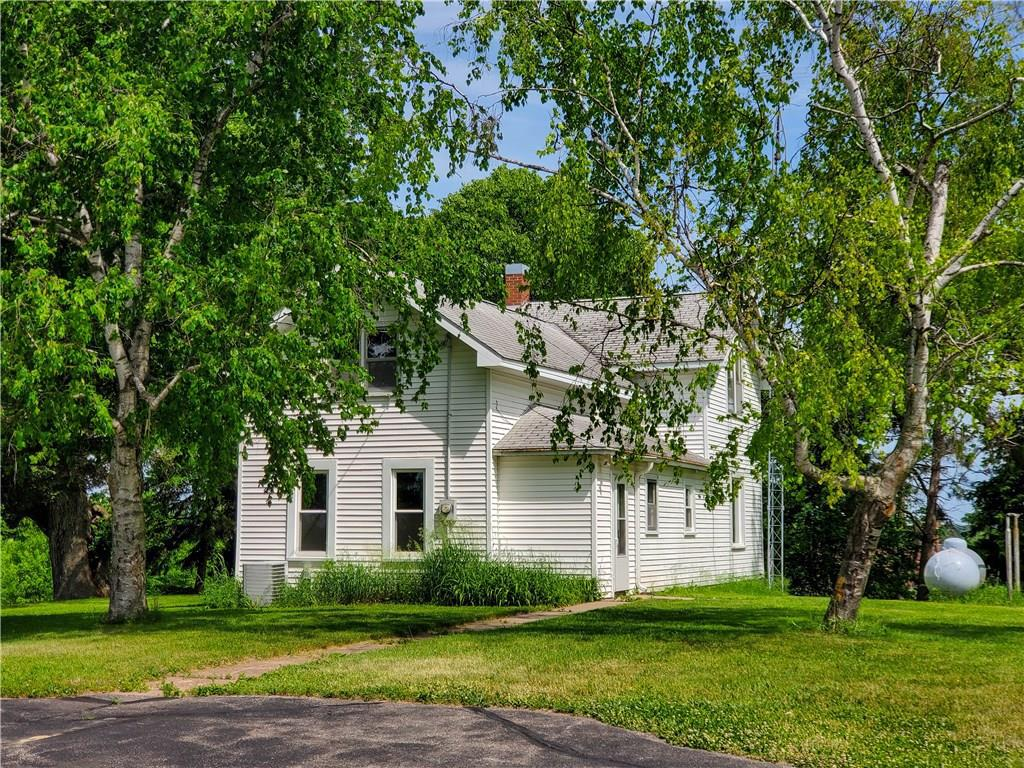 Great opportunity to own this large country home in a scenic setting on nearly 80 acres in the Village of Fall Creek! Only 10 minutes from Eau Claire, across the street from Fall Creek school and all village amenities. Updates include: new mound septic system, some new windows and doors, new roof on the barn, new laminate flooring, new hot water heater 2015. On the grounds you'll find an oversized 32x25 three car garage, 20x28 corn crib, 50x48 farm utility pole building, 14x14 pole building, 34x72 barn and 34x81 barn. Excellent development opportunities as well!