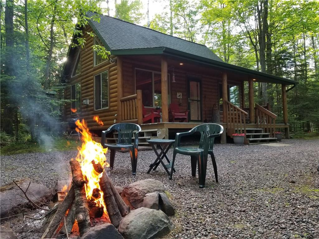 Get away from it all and enjoy this well-maintained chalet on 29.55 wooded acres(1.11 Acres and Cabin on the west side of the river and 28.44 acres on the east side of the river). On this property you'll find an abundance of wildlife including deer, grouse, bear and turkey. You'll also find that the Thornapple is a great place to fish, kayak and swim. The cabin gives you all of the comforts you'd want to enjoy your home away from home through all of the seasons.