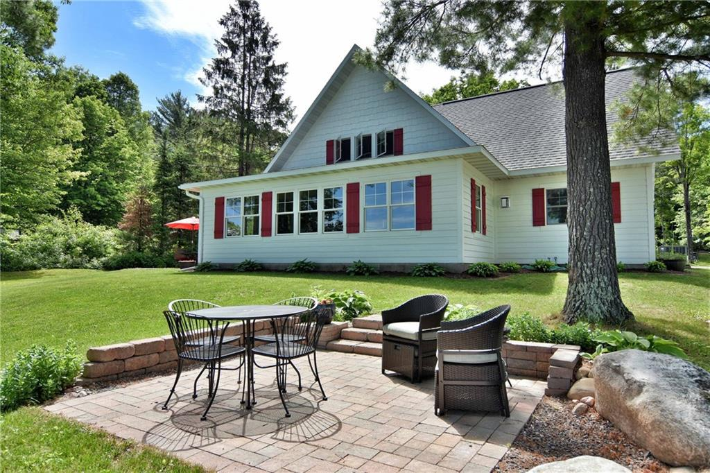 This stunning home on the mighty Chippewa Flowage is truly one of a kind, with 3 bedrooms, 2 full baths, soaking tub in master bathroom with walk in shower.  Built in 2014 this home offers all the modern comforts with open concept kitchen/dining and living room, large stone fireplace in main room with wall of windows over looking the lake.  Low elevation offers ease of access to lake, sand beach, beautiful landscaping, oversized 3 car garage, with over 3 acres of land. Make this your next get away!
