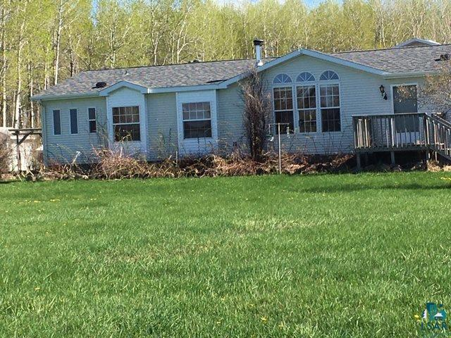 DON'T MISS THIS FARM HOME ON 40 ACRES CLOSE TO TOWN.  THIS 3 BEDROOM 2 BATH HOME DOES NEED SOME TLC.  HAS A LARGE GARAGE ATTACHED TO HOME THROUGH AN ENTRY DEN.  THERE IS ALSO A RED BARN THAT IS SET UP WITH HORSE STALLS AND THERE IS AN APARTMENT ABOVE.  ALL OF THE FARM EQUIPMENT IS INCLUDED IN THE SALE EXCEPT THE BEE HIVES AND TOOLS ASSOCIATED WITH THE HIVES.  4. There 3 artesian ponds on the property.