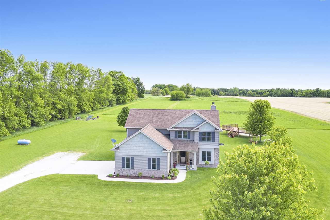 Quiet 10 ac country setting. sun flooded great room w/wall of windows, cozy fireplace and soaring ceiling. Applinanced kitchen w/hardwood floor, snack counter, walk-in pantry & dining area w/door to patio. 1st floor laundry. French doors to office w/built-in book shelves & window seat. Master suite w/tray ceiling, walk-in closet & private full bath w/dual sinks & soaking tub. Full lower level w/10' ceiling, stubbed for bath & awaits future expansion. 2.5 car attached garage w/direct basement access. Separate Deck area perfect for adding a pool. Perfect location for horses or hobby farm