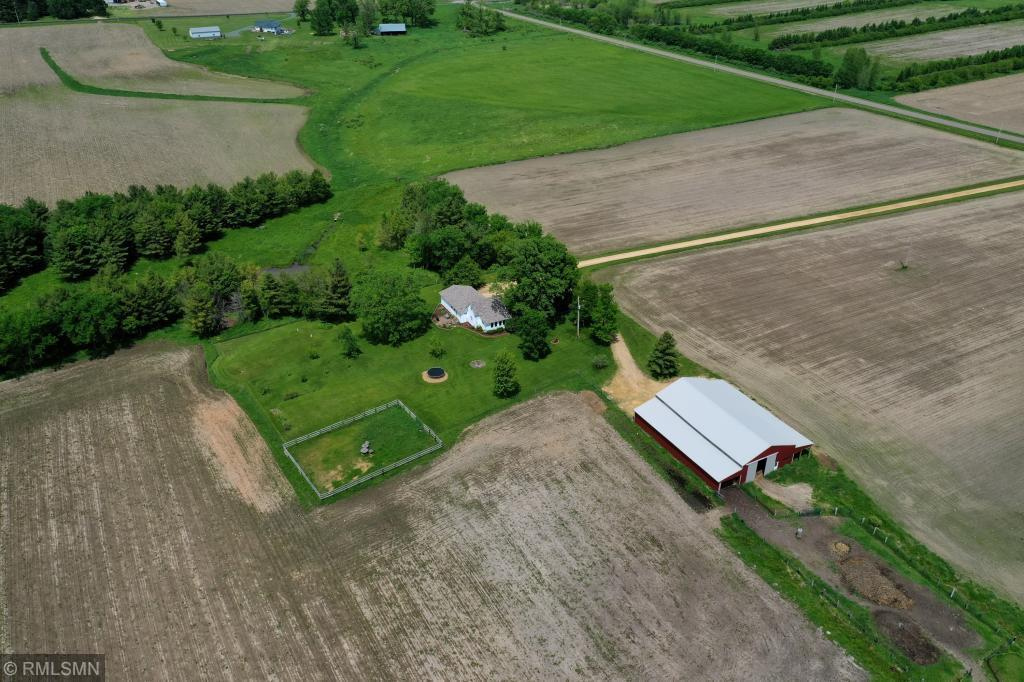 Attention hobby farm enthusiasts...this one has it all! This 40 acre property offers roughly 30 tillable acres, 40x80 pole shed with lean-to's and 16' tall doors, 80x56 outdoor arena, The pole shed is ready for your animals with 3 horse stalls, 2 chicken pens, a heated tack room, lofted hay storage, complete with electric and water. Stepping inside the home, you'll be greeted by a completely remodeled main floor.  Take your time and don't miss the intricate trim and cabinet detailing throughout! From new hardwood and tile flooring, to custom built kitchen cabinets and millwork. From the walk-in pantry to the vaulted living room ceiling, there is a surprise around every corner! Love landscaping and trees? This property has 2 plum trees,8 apple trees, 2 cherry trees, 2 pear trees, a non bearing fruit pear tree, green grape vines, red grape vines, walnut trees, and so much more! Simply gorgeous!Come check it our for yourself, there are just too many unique features to list!