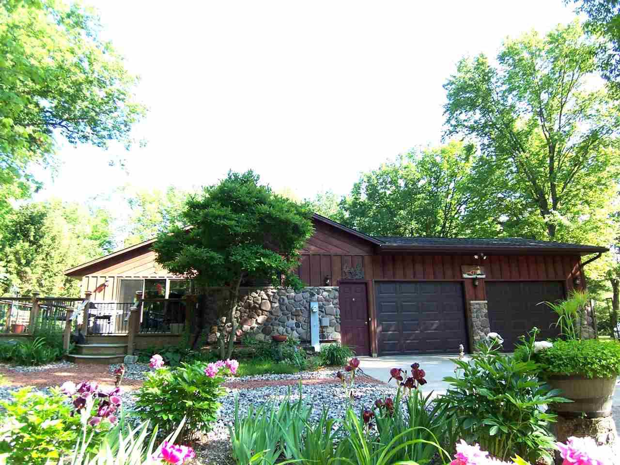 Rare find! 15 acres in desirable Suamico! Private setting, wooded with pond, stream, outbuilding & approx 1.5 acres fenced for your pets! Updated wk-out ranch w/2912 sqft finished, 4 beds, 2.5 baths. Kit w/newer beautiful mpl cabinets & stainless steel appliances. Dinette w/patio dr to backyard. Great rm w/brick fireplace & patio dr to deck. Master Ste w/priv full bath w/tub. Finished basement w/family rm w/bar, stone fireplace & patio dr, 4th bed, 1/2 bath. Beautifully landscaped with waterfall. 24x40 outbuilding w/horse stalls, 2 sheds, garden & more! Updates & features too many to mention!