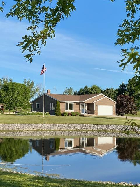 Beautiful home, 40x64 pole building and pond on 4.65 acres west of Fleet Farm in the Town of Manitowoc Rapids.  3 bedrooms, one currently used as the laundry room,  new siding and beautiful pergola off patio doors from kitchen.  Master bedroom includes bath with shower and spacious walk in closet.  Lot of room for your ''toys''...camper, snowmobiles, etc.