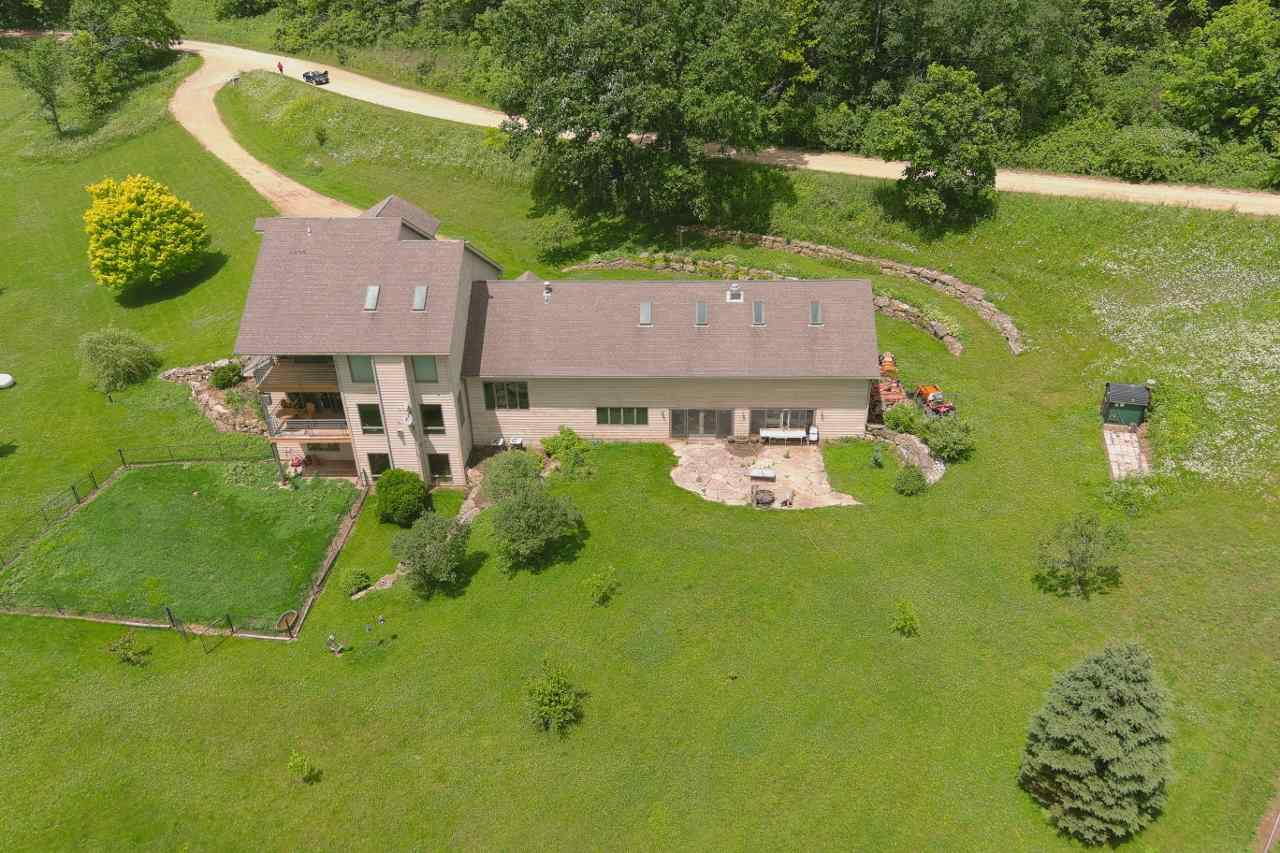 Remarkable residence nestled in a picturesque valley of distinctive Wyoming township on 18 acres w/ meandering stream. The dramatically designed residence boosts wide open curved staircases, vaulted ceilings, special loft area, coffee bar, 2 covered decks off kitchen & master bedroom & walls of windows that fill the home w/abundant sunshine. Main level sun room leads to an amazing in ground pool (16x32 is 3ft to 5ft) in a 30x55 space w/ access to a LL bath & walkout to back yard. Master suite offers special layout of bath area, sinks, shower, sleeping, & closet. Walkout LL has family area, spacious bathroom & plenty of storage area. The land has various fenced pastures w/ 2 run in shelters for horses, plus fenced yard for your pets &chicken coop. Outside wood burner is second heat source.