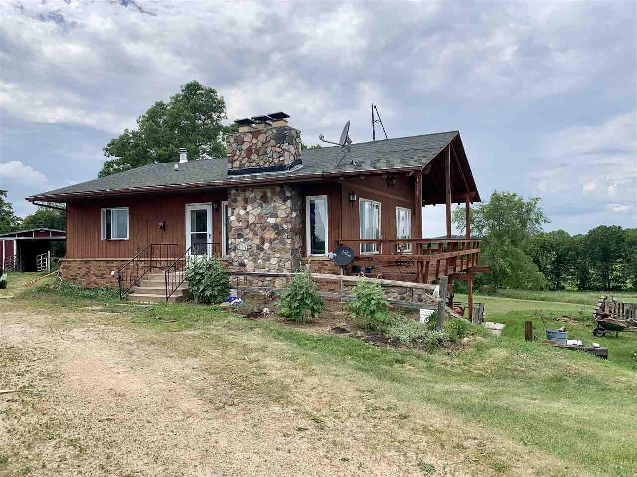 Private Country Retreat includes 18 Acres! Currently being as a Horse Ranch!  Property features 3 bedroom, 2 bath ranch with walk-out. 32x64 outbuilding with 6 stalls, 20x24 heated detached garage & 5 loafing sheds. Majority of land is fenced in. Roof '08; Furnace/Wood burning 2010. $200 HOA fee is for private road maintenance.