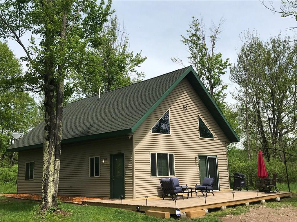Everything completed & finished within last few years, in this 2Bdr/1Bath Chalet with loft. Finishes are well thought-out with modern open airy lines. In floor heat, new kitchen cabinets, fixtures & stainless appliances. Also has main floor laundry, laminate floors and vinyl sided! ! Well insulated for year round living with spacious loft & deck.  Extra touches include security system, new large deck & storage shed. Very private on 5 well wooded acres in recreational area with direct access to ATV/Snowmobile trails & minutes to the Chippewa Flowage Boat Landing!  About half hour to Hayward or Ladysmith for all your necessities.  Step into  Northwoods living with comfort and class!