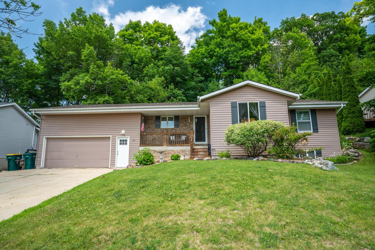 Tastefully done 3 bedroom raised ranch in the highly sought after Slinger School District. Open concept with vaulted ceilings and skylights to bring in natural light. Large kitchen with breakfast island and dinette area. Patio doors lead to a secluded deck overlooking mature trees. Spacious LV and HWF throughout. MB with attached spa like bathroom with french doors, double headed WIS and jetted tub. laundry, 2nd bedroom and fully updated bathroom complete the main level. Finished LL with 3rd & 4th bedroom, bathroom, and rec room. Short walk down steps to a 2nd private deck. 2.5 car attached garage.