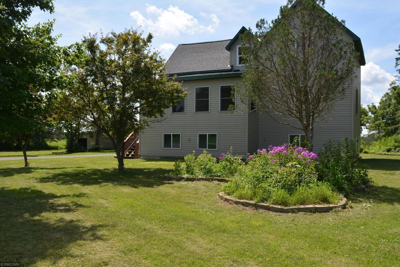 5.99 Acres of Country Living at its Best,   St Croix Falls School district. This 5 Bdrm Home 2.5 detached garage along with a outbuilding 22x38. This home has the warm feeling with natural wood   throughout the home. Tiled finished basement, New Roof on home/garage,New cement in garage, Large kitchen for the family to gather, wrap around porch to enjoy the scenic views.Dishwasher will be installed prior to closing. Price to sell quick All Offers will be presented & reviewed by Seller on  7/19/2020 5pm
