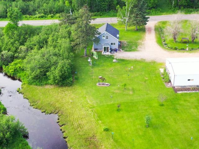 Look No Further!Here is the well maintained 3 bed 1 bath river property with 3 acres that you have been looking for. This property boasts so many great features such as the 650ft of frontage on the West Branch of the Eau Claire River, horseshoe shaped driveway, with a tall heated 4 car garage with a large work bench. The 1st floor features laundry, stainless steel appliances,Knotty Pine wood walls, and laminate floors that bring a very at home cozy feel. The upstairs has new carpet, a large bedroom, and a spacious landing that has an amazing view of the flowing river. Imagine enjoying your morning coffee as you listen though your 4 season porch to the soothing sounds of the river and birds chirping every morning as you take in the spacious flat yard with an abundance of fruit trees, grape vines, and 100's of different flowers that are constantly blooming throughout the seasons. This is one that you truly need to see in person to appreciate.(Adjacent Property AVL. View Realtor Remarks),Additional living quarters with 2 acres boarding the EAST property line is Available..... Separate MLS #: .....COMBINED Acres total: 5....COMBINED price of $130,000 (One hundred and thirty thousand dollars and 00/100).                                                                        020-0080.001