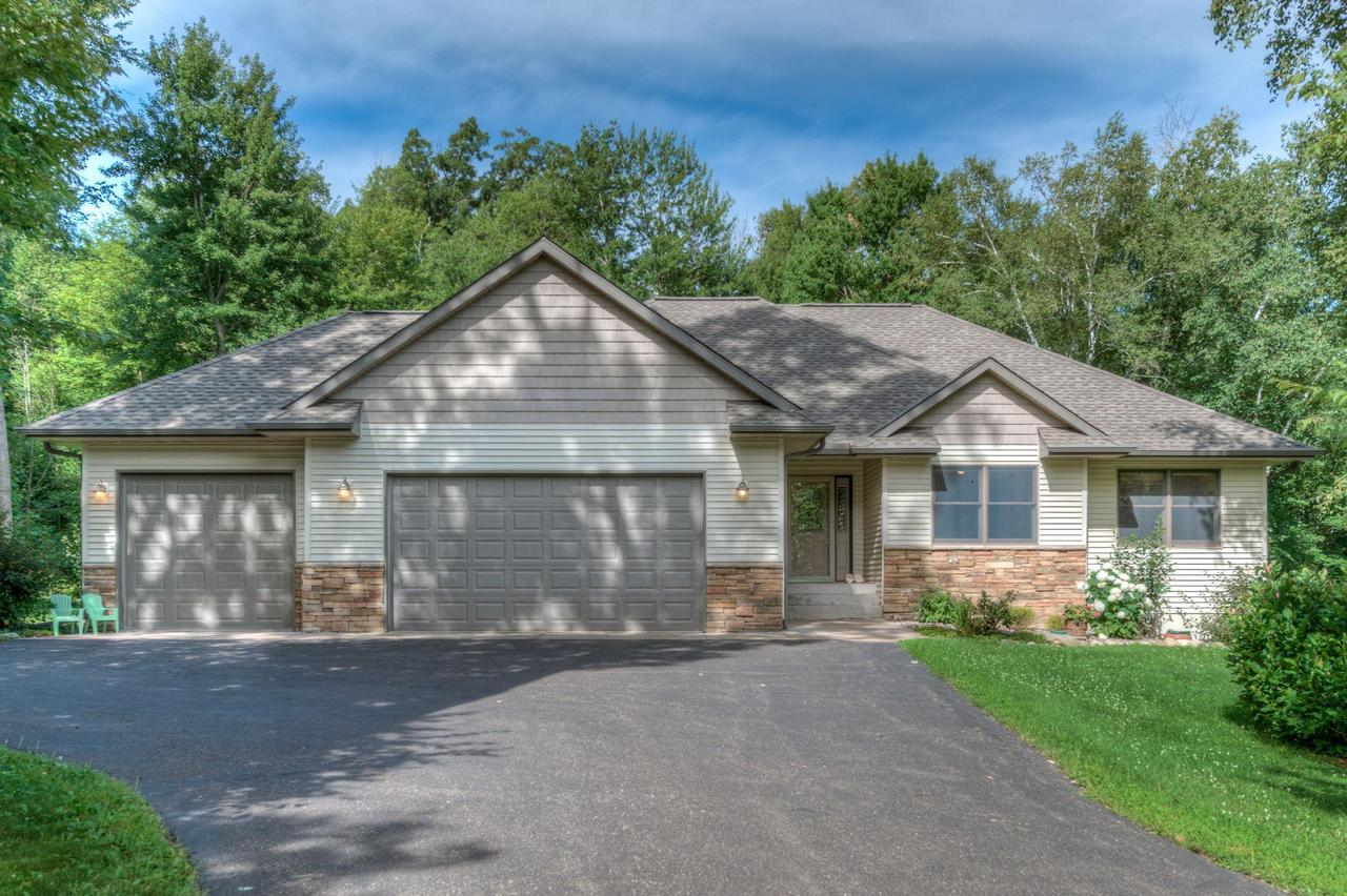Beautiful woodwork, vaulted living room ceiling, gas fireplace, large master suite with whirlpool tub. 3 bedrooms on main level with main floor laundry.  Lots of space inside and out. Outdoor entertaining space with over 2 acres of wooded privacy and blacktop driveway.  Wildlife out your doorstep! Quality kept home, must see!