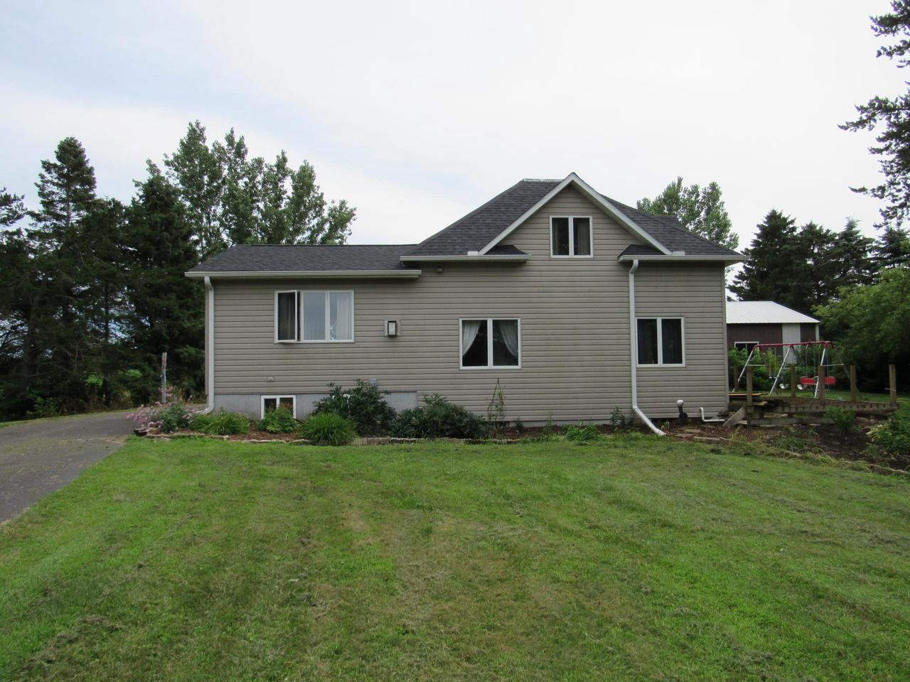 Cute country living on 5 acres, open kitchen/dining room with upgrades, huge living room with fireplace, basement has large man cave/playroom. 2 upper bedrooms and bath. New septic will be done by August 2020. Large pole shed for the toys, detached garage with separate workshop. Call today!