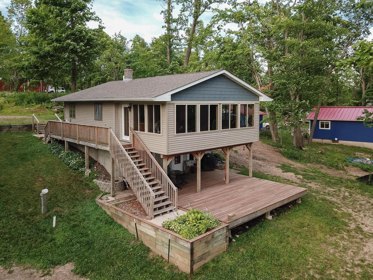 This nice and neat custom-built year round home has a unique floor plan that really addresses the Lake. The walk out and views to the lake are awesome. The home has in floor heat, a walkout lower level, and a fantastic vaulted ceiling lakeside family room. The huge deck overlooks the north end of Big Round and you'll have all the fish you can stand, right off the dock.