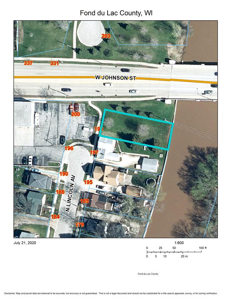 Lot for sale. Possibly for expanding a business parking area or as an investment. Zoned commercial.
