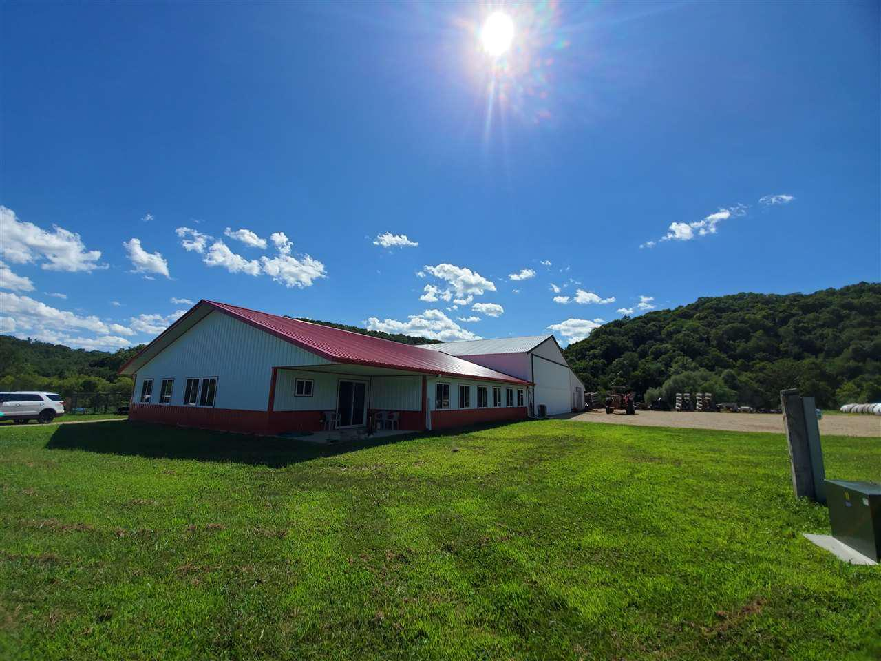 Located in a beautiful valley is this 46 acre property with wooded hillside views. Included is 6 acres of wooded area and 10 acres tillable land. Citron Creek provides over half a mile of frontage on a DNR rated trout stream. New constructed house in 2019 on a cement slab connected to a 50x90ft shed. You will love this 4 bedroom and 2 bath farm style house with steel roof siding. House features include: in-floor heat and central air, cherry custom cabinets & mosaic tile in kitchen, 6x8ft walk in pantry, cathedral ceilings, ash trim, ash hardwood flooring, and some tile flooring throughout. More features include: great room, 10x10 ft master bathroom with walk-in closet & lifetime windows waranty. Shop attached is insulated with plenty of storage & a 16x42ft bi fold airplane hanging door.
