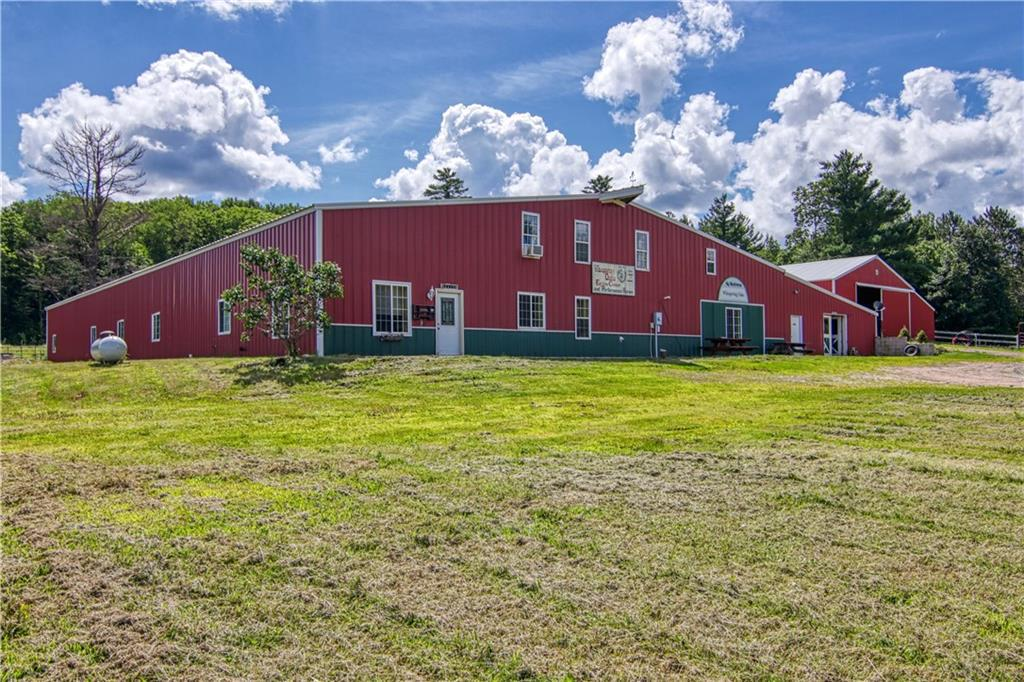FIRST TIME OFFERED. Horse Boarding and Indoor Riding Arena plus Residence. Located 15 minutes southwest of Hayward on nearly 40 acres of pasture land and some woods. This is a combination of living space and riding stable and arena. The main building includes a 122' x 80' riding arena and a 150' x 32' area with 21 individual stalls, a wash bay plus a tack and feed room. The remainder is a two bedroom apartment suite including a kitchenette, living room, full bathroom and mechanical/laundry room. The other area is a large two bedroom home with a kitchen, living room, office, upper level rec room plus two full baths and two half baths. There is also a 64'x42' cold storage building and an outdoor riding arena plus pasture. Known as Whispering Oaks. Room measurements are for both the main living space and the apartment.