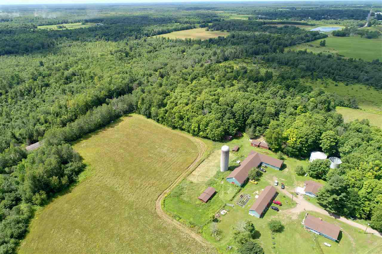 "Nestled on the outskirts of Hawkins, WI. with the Morgan Creek running through it, this 177 Acre farmstead is accompanied with the following; Main 4 Bed/1 Bath Home, Additional 2 Bed/1Bath Home, 34x100 Barn, 30x80 Barn, 16x30 Shop, 2 Cottages and 3 Silos. This property can be utilized in many different ways; Investment property, Hunting Land, ""Up North"" Getaway, Full Farm, Hobby Farm, Wedding Destination, the possibilities are endless! Currently main homes are being ""rented"" with leases expiring in Jan 1 and Feb 1 of 2021. This property is being sold AS-IS."